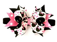 Missy Mouse Baby Headband - If you're on your way to Disneyland soon, this headband is for you!   A great deluxe headband featuring a beloved mouse printed ribbon in pink, bubblegum, and black polka dots.  Hair bow is permanently attached to your choice of headband styles.  Black shimmer stretch elastic is featured in this photograph on a medium sized 4.5 inch bow.  www.PinkBowtique.com