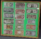 A FRAMED COLLECTION OF BANK OF ENGLAND, COMMONWEALTH AND WORLD BANKNOTES, to include 'Malaysia and British Borneo' 1953 $10, $5 and $1, Bank of England 'Peppiatt' lilac 10/- etc.