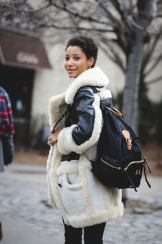 Lessons In Layering From The Streets Of New York City #refinery29  http://www.refinery29.com/2016/02/103173/ny-fashion-week-fall-winter-2016-street-style-pictures#slide-20  This two-toned shearling number is exactly what we need to beat this weather....