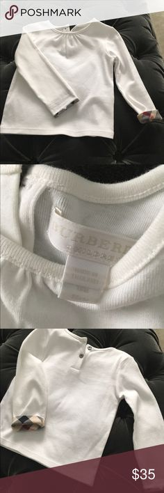 Burberry white top New Burberry white top size 18 Months , cotton/elastane , machine washable . Runs thru to size. Burberry Shirts & Tops Tees - Long Sleeve