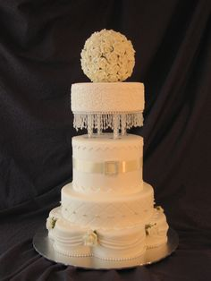 """Wedding Planning Expo Wedding Planning Expo 14"""" 6-petal base, 10"""" round and 3 x 8"""" rounds, with pillars holding top tier. Topper is a ball of..."""