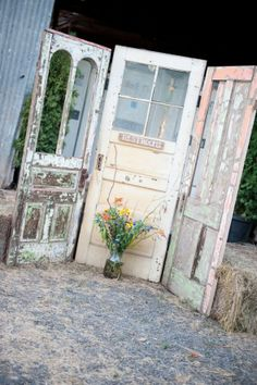 Old doors you can sand to use as backdrops.  dont know about craigslist there, 2nd hand stores, the refuse, but you might find them for nothing!  sand them after white washing...beautiful