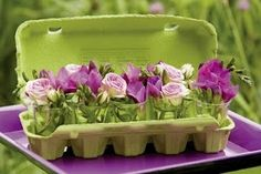 egg carton with shot glasses for little vases, and gorgeous flowers