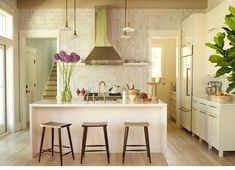 Carry backsplash tile all the way up the wall to ceiling. Via http://www.angiehranowsky.com/interior/1-Interior-Design/31-latitude-lane