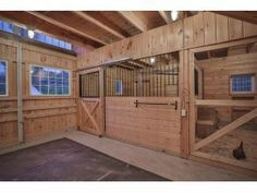 stalls for horses and chickens. perfect (no chickens in my horse barn...ever! but I do like the stall and windows in the sliding doors