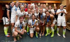 The United States team celebrate in the dressing room after winning the FIFA Women's World...
