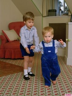 Prince William standing behind his brother, Prince Harry, in his playroom at Kensington Palace