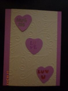 Embossed background with Lavender Heart Candies