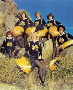 vintage cheerleaders/ wool pleated skirts and pullover sweaters.  Our school colors:  Kelly Green and White.