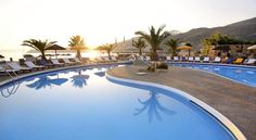 Far Out Village Mylopotas Surrounded by shaded gardens on Mylopotas Beach the Cycladic-style Far-Out Village Resort Hotel offers a swimming pool, bar and restaurant. It features elegant accommodation with balcony.  Rooms here will provide you with a TV and air conditioning.