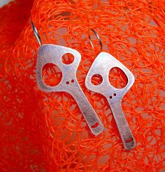 Copper and sterling silver skull earrings. Two lanky dead guys perfect for your crazy ears. Also available in brass by themonsterofmyheart on Etsy https://www.etsy.com/se-en/listing/82589665/copper-and-sterling-silver-skull