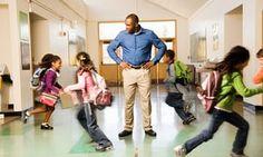Teacher with students running around him