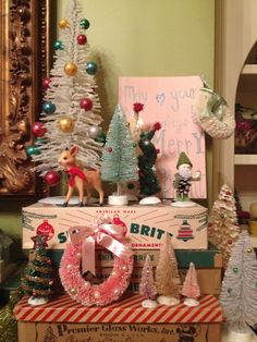 Vintage Christmas bottlebrush trees on mantle