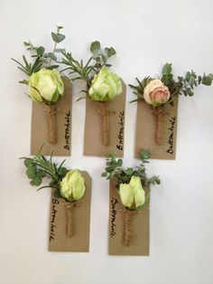 Spray Avalanche Buttonholes with one Bombastic Rose for the Groom