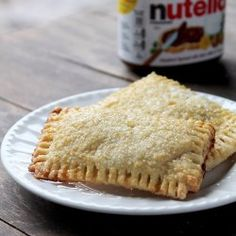 Homemade Nutella Pop Tarts [2 refrigerated pie crusts (You can use store-bought or homemade) | 1 cup Nutella | 1 egg yolk | 1 teaspoon water |  Turbinado Sugar]