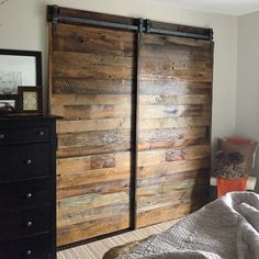 Barn doors for closet in master bedroom. They are sliding on our patent pending single track bypass hardware. Custom made by 1925workbench