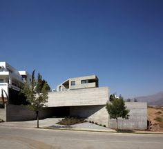 Completed in 2012, this concrete house in Las Condes, Chile, faces out towards the mountains with a spectacular vantage point overlooking the expanding city. Photography: Cristobal Palma/Estudio Palma