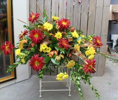 Red and yellow casket spray