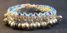 White & Blue Gypsy Belly Dance Jingle Bell Bracelet Handmade by FireGoddessGlass - Free Shipping. $25.00, via Etsy.