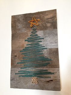 Classic Christmas Wall Trees To Copy Right Now Show your string art on this Christmas.Show your string art on this Christmas. Christmas Art, Christmas Projects, Christmas Decorations, Diy Christmas Wall Decor, Christmas Stairs, Creative Christmas Trees, Pallet Christmas Tree, Christmas Fashion, Christmas Baubles