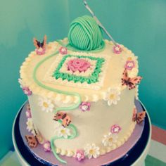 Peggy Porschen Scumptious Carrot Cake decorated with sugar paste and royal icing in a spring crochet theme