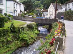 Polperro (with its streams filled with trout), Cornwall, England. To get to Polperro, you can take the car and then park it at a lot above the town. The Southwest Coastal Path goes to the town.