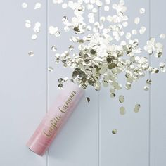 Lovely pink ombre confetti shooter with stunning gold confetti inside, perfect for your next party! Contains compressed air with no explosives.Make a confetti shower with this confetti cannon shooter. Our cannon shooter is perfect for parties and celebrations. The pink ombre design and gold confetti inside is perfect to make a loud confetti bang at your celebration. Each cannon shooter is 15cm H. Contains compressed air with no explosives! These go great with our hanging decorations and…