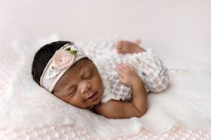 african american newborn girl back-lying pose pink and cream