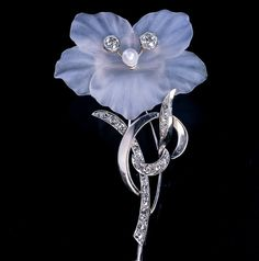 Made in Vienna, Austria in the 1940s -1950s This large vintage brooch is designed as a delicately hand carved frosted rock crystal flowerhead embellished w