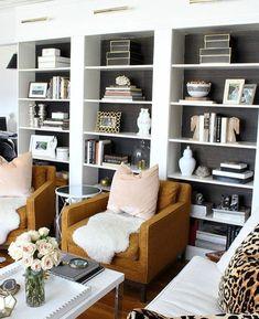 Image result for built in bookshelves middle of windows