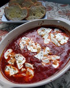 Goat Cheese Marinara    Ile de France goat cheese  marinara sauce  fresh garlic  basil  french bread    Preheat oven to 350.    Pour marinara into baking dish. Slice goat cheese and place on top of marinara.  Sprinkle with basil and garlic.  Bake 15-20 minutes, until bubbly.  Serve with toasted french bread.