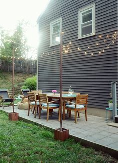 Ive always loved the look of bistro lights in outdoor spaces, but our patio didnt have anywhere to to attach the string lights. Click through to find out how to make your own cement box-mounted posts to attach your string lights to. Small Patio Design, Backyard Patio Designs, Diy Patio, Patio Ideas, Backyard Decks, Landscaping Ideas, Yard Ideas, Backyard Landscaping, Backyard Lighting