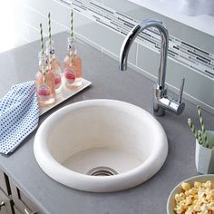 "Pozo concrete bar sink boasts organic beauty and one-of-a-kind coloration; its wonderfully functional deep, circular shape creates a stir. Bar and prep sink 16"" x 8"" Comes in Pearl, Slate and Ash"