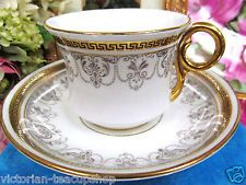 PHEONIX TEA CUP AND SAUCER GREEK KEY PATTERN GOLD TEACUP