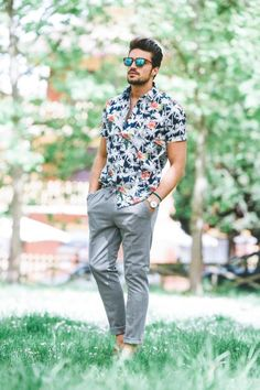 Dark Blue Printed shirt styled with Grey Dress Pants and one can finish this outfit by wearing Blue Espadrilles