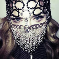 'A woman's work is never done!' Madonna brushes her grills before heading out…