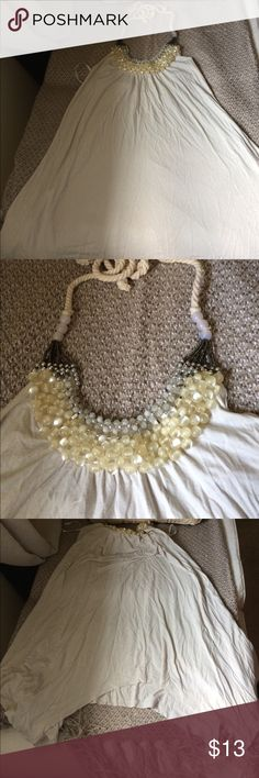 Beautiful cream colored jeweled halter top Pre-loved has a lot of life in it ! No missing Jem's. Prettier in person! New York and company Tops Tunics