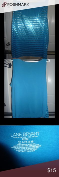 Sparkling Blue Lane Bryant Tank **Size 22/24** Sparkling Blue Lane Bryant Sequin tank. This gently-used top catches the light and looks incredible. Pair this with a blazer for work and then off for some drinks with the ladies. Size 22/24 💕BUNDLE TO TAKE ADVANTAGE OF 15% OFF & TO SAVE ON SHIPPING 💕 Shiny, Great Layering Piece, Sparkles, Plus Size Lane Bryant Tops Tank Tops