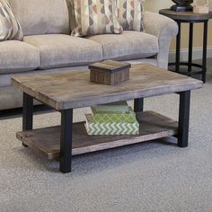 The Pomona Rustic Natural Coffee Table features exquisite workmanship crafted with a solid reclaimed wood top and metal legs and a lower wood shelf for additional storage. The natural finish provides