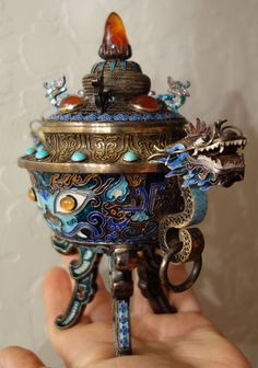 """Antique Chinese silver filigree and enamel censer with turquoise, coral and carnelian, dating to the late 19TH to early 20TH century. It measures 6.5"""" tall by 3 3/8"""" wide from dragon nose to dragon nose. Excellent condition with no missing or chipped stones or dents. Enamel in great condition with no damage. Marked """"SILVER"""" on the base. 3 of 3 photos. svradg 