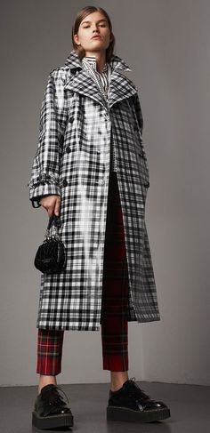 Burberry A high-gloss laminated Modern Scott tartan wool trench coat. The relaxed cut has an undulating storm shield and inverted box pleat at the back for volume. Mix your patterns to make the plaid pop. Trench Coats, Burberry Trench Coat, Rain Slicker Womens, Tartan, Fashion Models, Fashion Outfits, Women's Fashion, Langer Mantel, Raincoats For Women