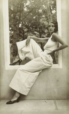 The casual lady enjoys a lazy summer Sunday in the 1930's...wide legged pants and a tank top with a whisper of a Marcel wave...