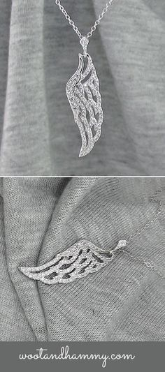 Gorgeous angel wing pendant encrusted with tiny cubic zirconia crystals in sterling silver.