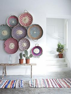 colorful woven baskets on wall