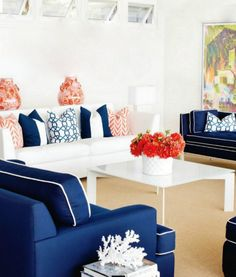 Perfect for a summer cottage! Love the fact that the basic living room decor is done in white and blue.... so in a next season you can do white, blue and pink and keep switching the color accent! Coveting those white and blue sofas with white and blue piping...!