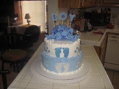 the cake was frosted with  whipped cream  and the feet and hearts were molding chocolate the boy was made out gumpaste