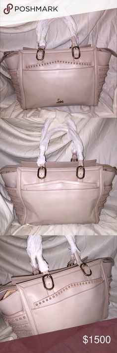 "Nude/Beige Louboutin Farida Bowling Bag NWT $2000 •Amazing Nude/Beige Color. •Very Trendy! NEVER CARRIED •Will go lower just ask! •NEW WITH TAGS •NO BOX OR DUST BAG• DIMENSIONS LENGTH: 18""; STRAP DROP: 5-9"" ; DEPTH: 5"" ; HEIGHT: 10"" •Minor marks on bag from storage (there are 3 total;not noticeable)•Last pic Bottom right shows bag next to body Christian Louboutin Bags Totes"
