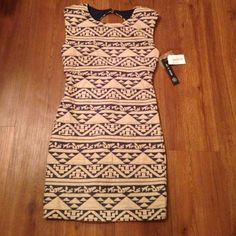 """Geometric print peep hole dress Brand new, purchased from Dilliard's. JUNIORS size small, equivalent to womens size XS or size 2. Retail price $59. Material: 51% polyester, 45% cotton, 4% spandex. Has a 100% polyester lining on the inside. Length is 32"""" As U Wish Dresses"""