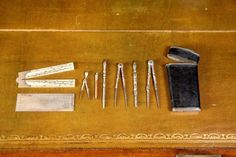 John Wood the Elder's (1704-54) set of drawing instruments, which were sold to the Bath Preservation Trust at Clevedon Auction Rooms for £21,000. One vacant aperture would suggest that a piece is missing, although a silver scale ruler, an ivory sector ruler with silver mounts, compass, dividers, bow, two pens and a pencil have all survived in excellent condition. Some minor conservation work will be needed to repair a hinge.