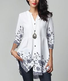 Flatter your frame as you enliven your look with this flowing top boasting stretch fabric that effortlessly accommodates your every curve.Note: This is a one-of-a-kind item; prints may vary.Made for zulilyModel: 5'8'' tall; 33'' chest; 24'' waist; 35'' hipsSize S: 33'' long from high point of shoulder to hemSheer; base layer recommendedWoven100% polyesterMachine wash; hang dryImportedShipping note: This item is made to order. Allow extra time for your special find to ship.